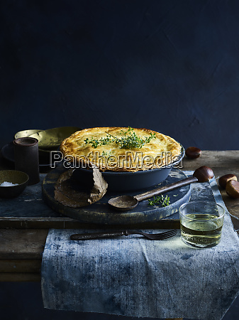 chicken pie with glass of white