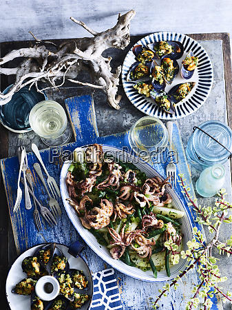 baked baby octopus and mussels served