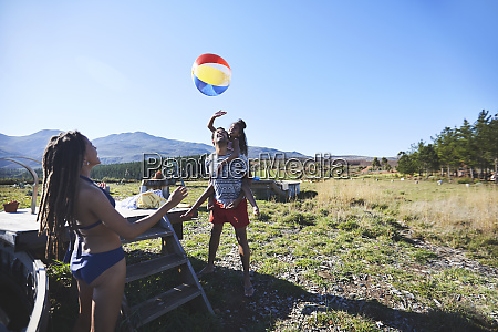 happy playful family with beach ball