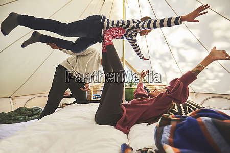 playful family in camping yurt
