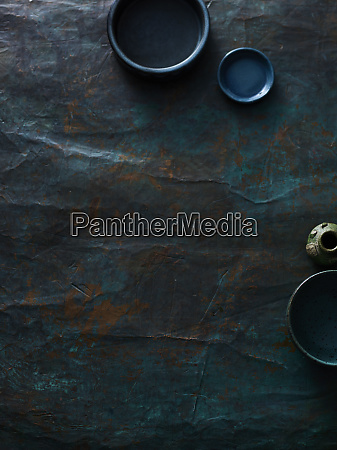 empty small plates on textured surface