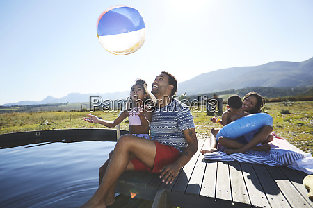 playful family with beach ball at