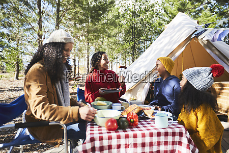 lesbian couple and kids eating at