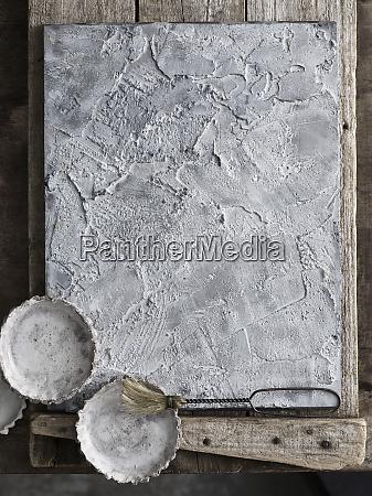 tartlet tins on textured slate tray