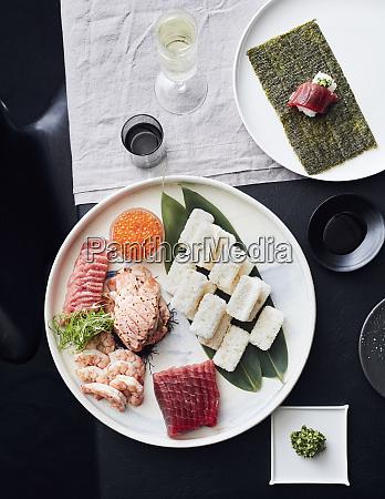 plate of sashimi and sushi served