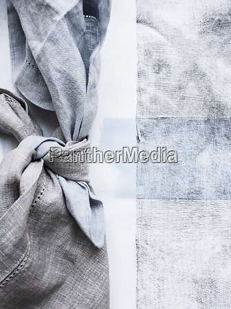 still life of tied blue napkins