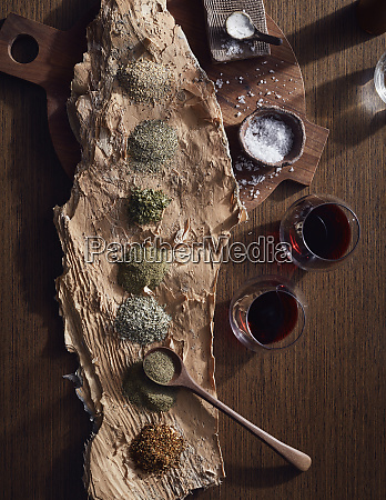 variety of bush spices on log