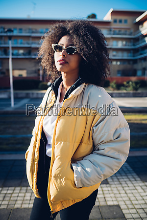cool young woman wearing sunglasses on