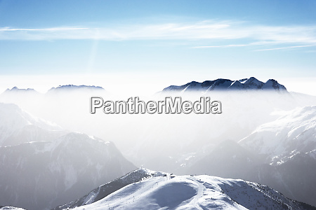 snow covered mountain landscape with mist