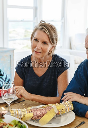 woman listening attentively at dining table