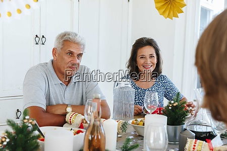 senior couple talking with family at