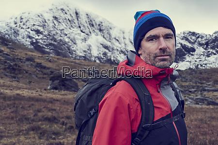 male hiker in knit hat by