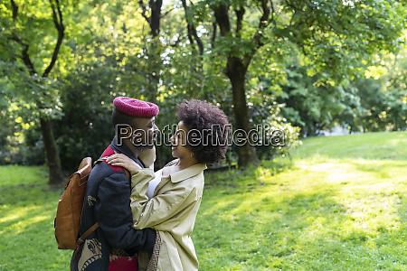 couple hugging in park milan italy