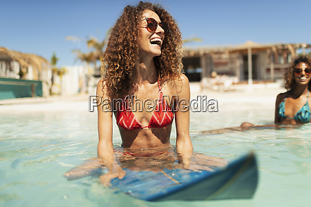 happy young woman on surfboard in
