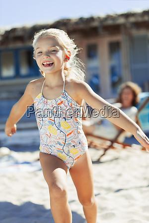 carefree girl in bathing suit running
