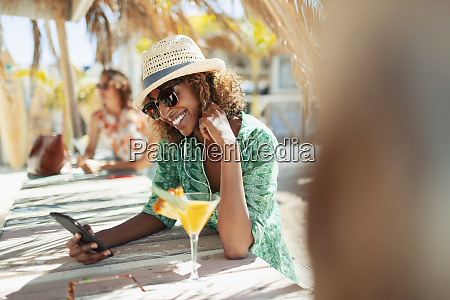 happy young woman with smart phone
