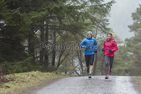 couple jogging in woods