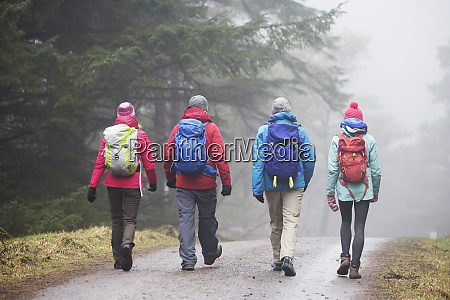 family hiking in rain