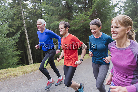 family jogging in woods