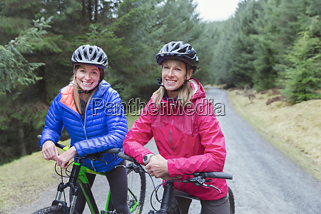 mother and daughter mountain biking