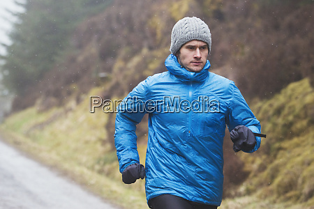 man jogging in rain