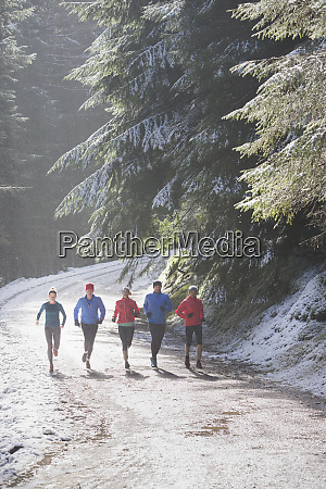 family jogging in snowy woods
