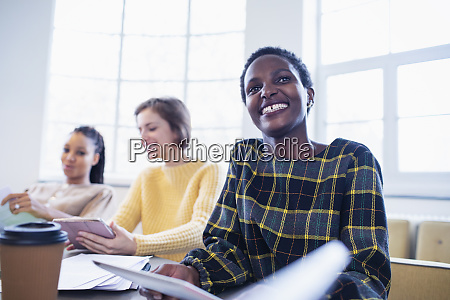 happy confident businesswoman in conference room