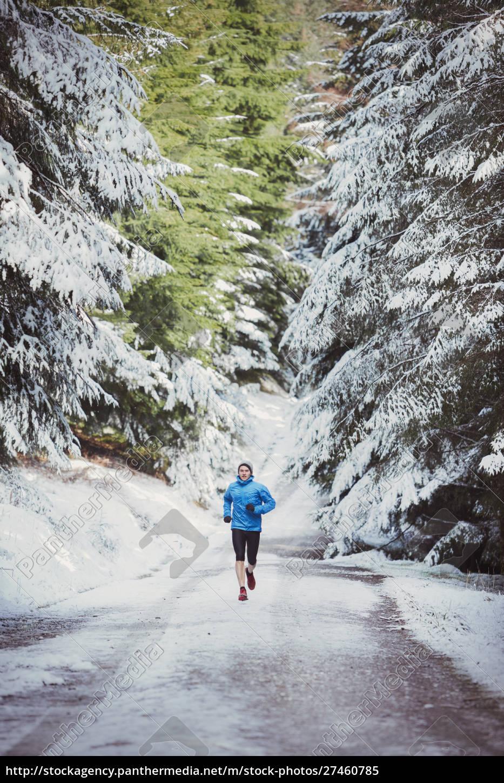 man, jogging, in, snowy, woods - 27460785