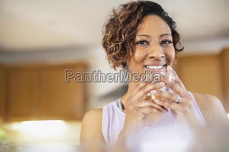 portrait smiling confident woman drinking tea