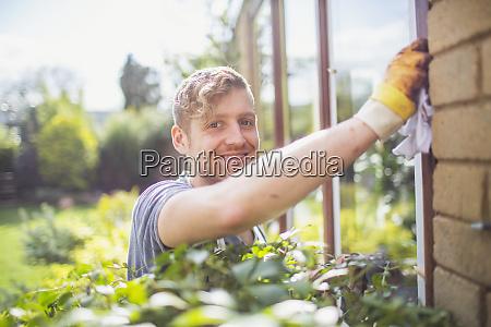 portrait smiling confident male worker installing