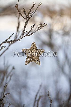 outdoor christmas decoration with wicker star
