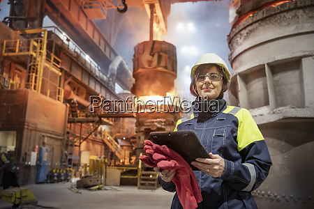 portrait of female steelworker during steel