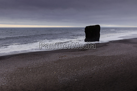 coastal landscape with overcast sky and