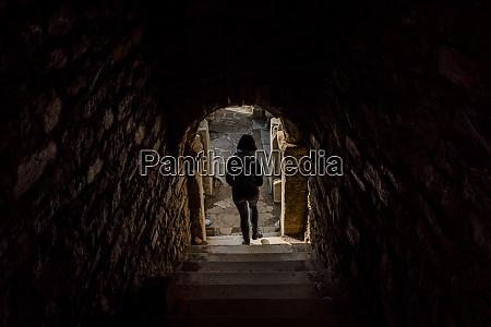 woman walking down steps in stone
