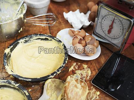 messy baking preparation on kitchen table