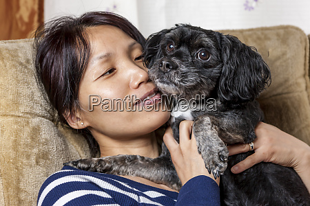 tender moment between woman and small
