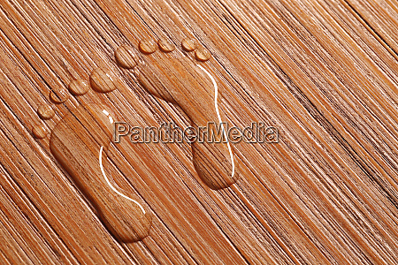symbol of two footprints on wood