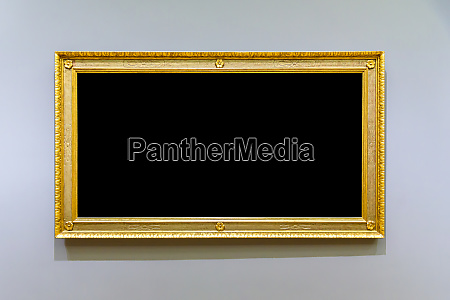 empty golden picture frame on the