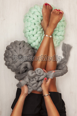 young woman knit chunky merino pouf