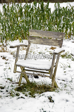 snow covered chair in the snowy