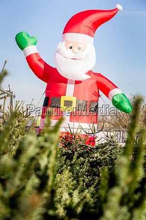 santa claus figure on christmas tree