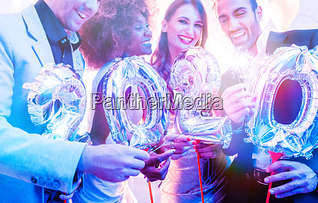 men and women celebrating the new