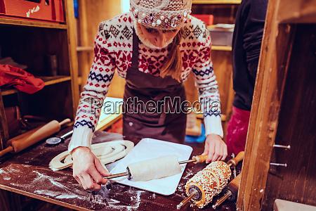 woman on christmas market making traditional