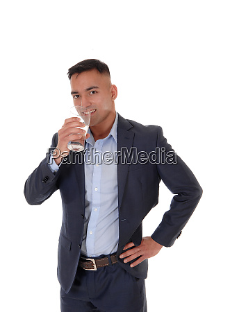 thirsty man drinking a glass on
