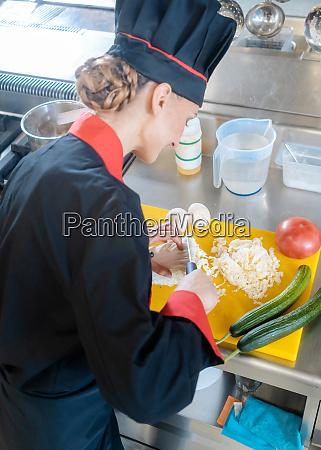 chef slicing cauliflower