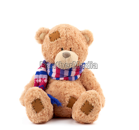 cute brown teddy bear with patches