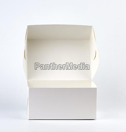 empty open white cardboard box on