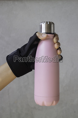 fitness glove hand on water bottle