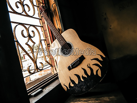 an acoustic guitar placed next to