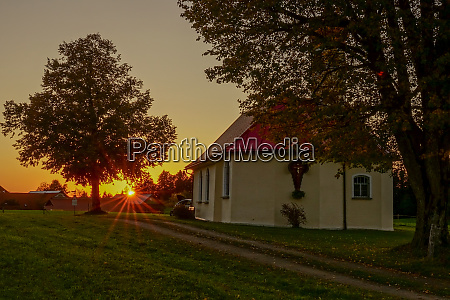 chapel with rays of evening sun